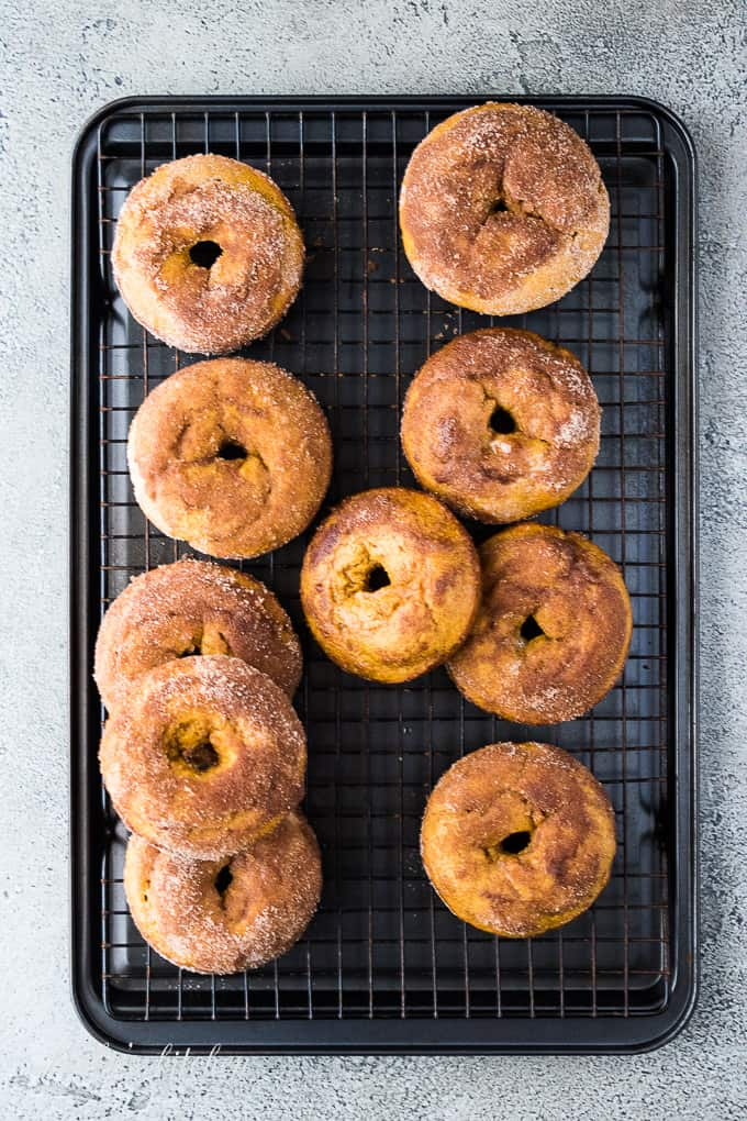 The cinnamon and sugar topped breakfast treats on a cooling rack.
