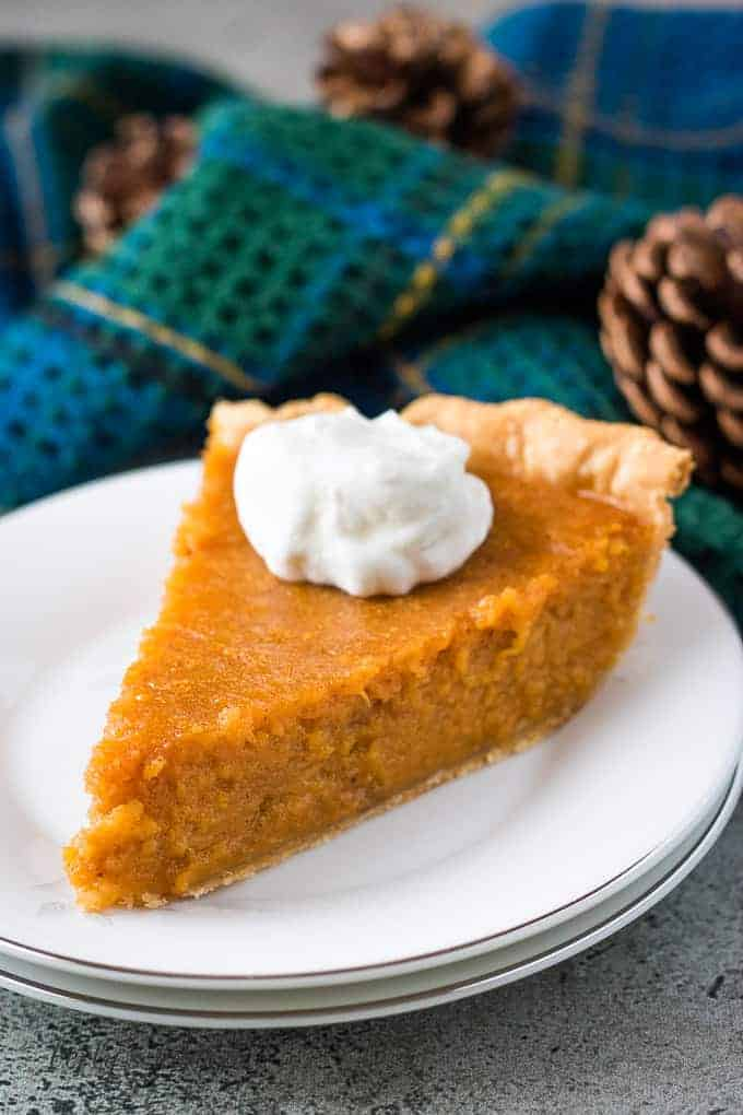 A small slice of sweet potato pie on a plate.