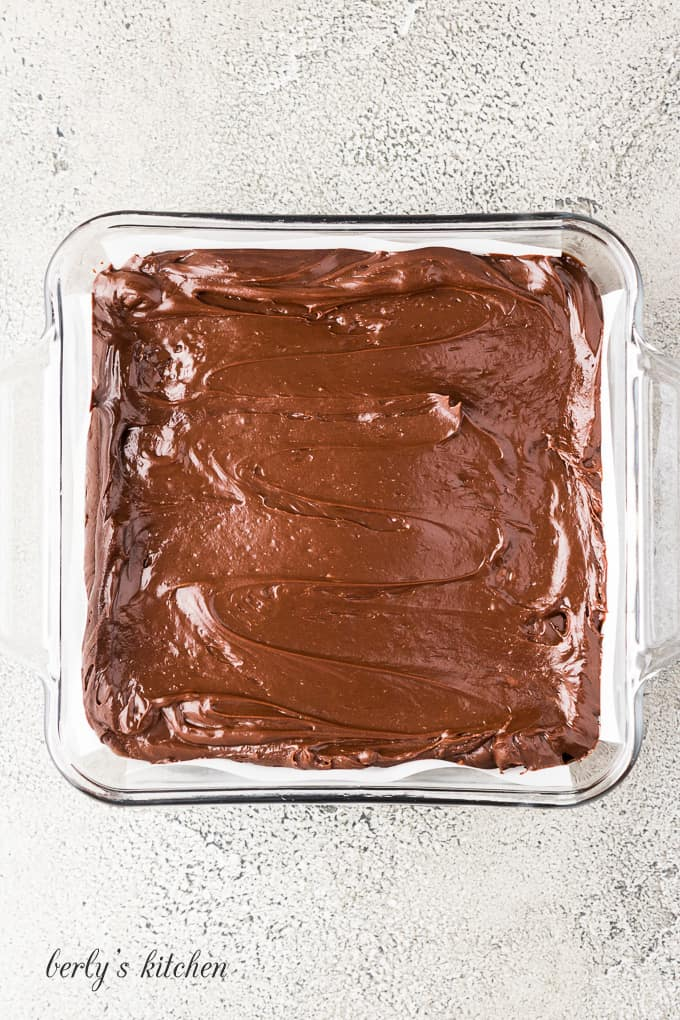 The fudge has been transferred to a prepared casserole dish.