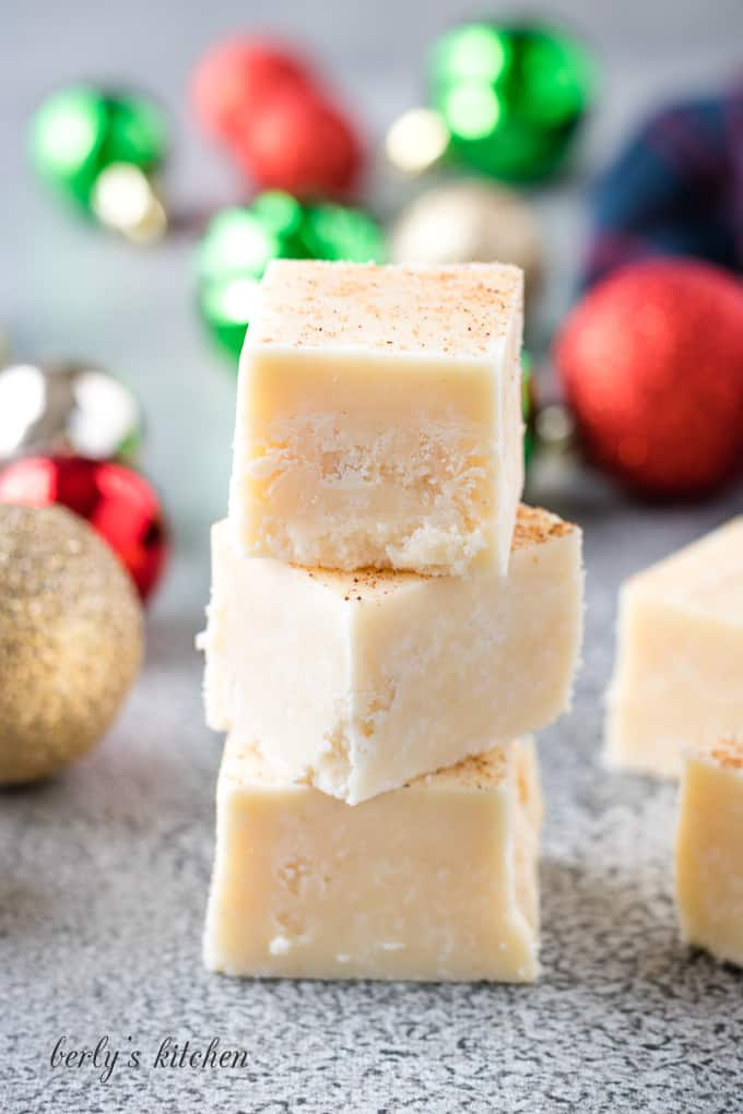 The finished eggnog fudge stacked on a counter-top.