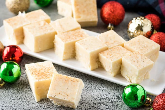 Multiple pieces of eggnog fudge on a plate.