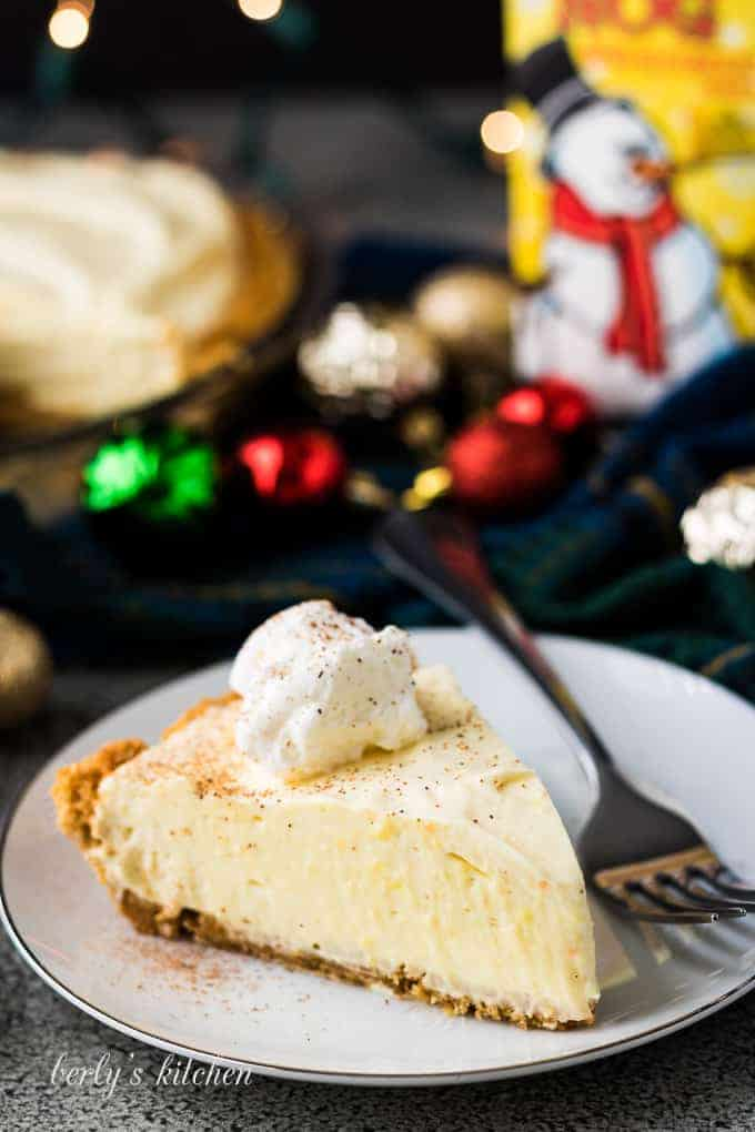 A serving of the eggnog pie topped with whipped topping.