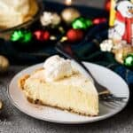 A slice of the eggnog pie surrounded by festive decorations.