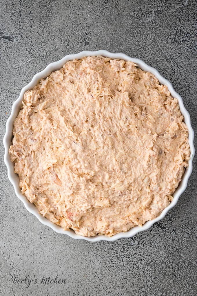The crab dip has been transferred to a tart pan.