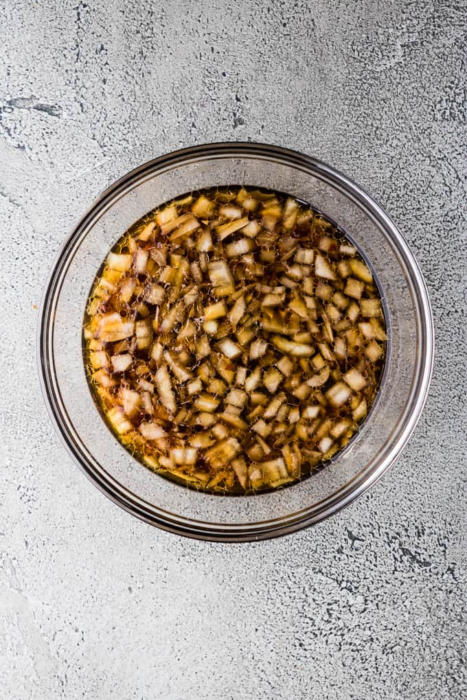 Ginger, soy sauce and other ingredients in a large mixing bowl.