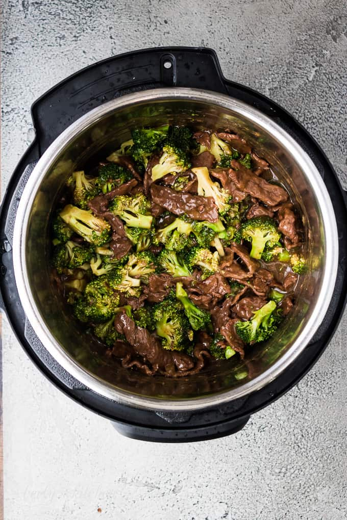 Steamed broccoli has been stirred into the beef and sauce.