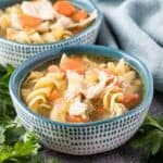 Two decorative bowls of the Instant Pot chicken noodle soup.