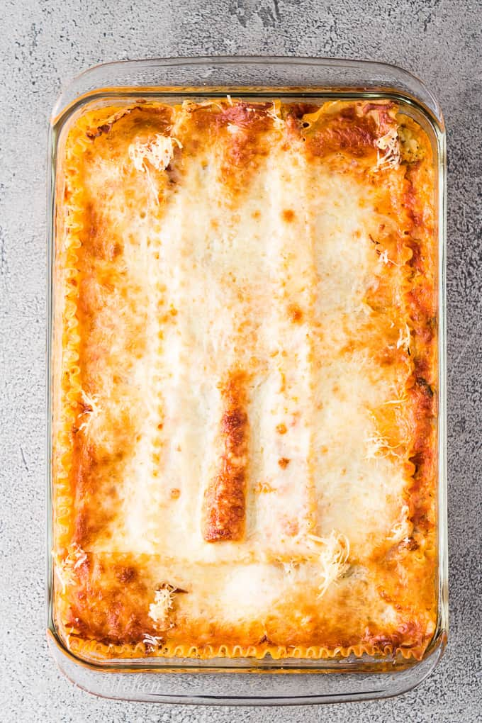 The lasagna has cooked and needs to cool before serving.