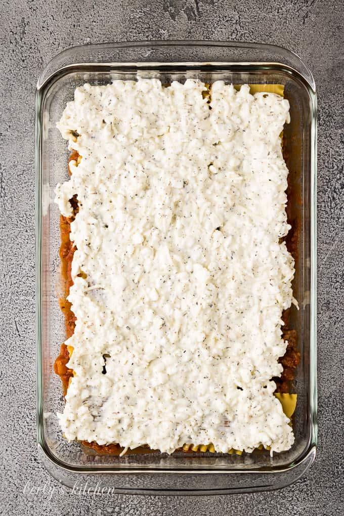 The mozzarella cheese filling evenly spread over the lasagna noodles.