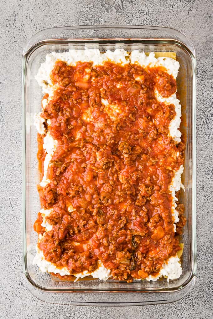 More meat marinara has been spread over the cheese mixture.