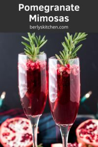 The pomegranate mimosas garnished with a sprig of fresh rosemary.