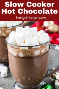 A mug with slow cooker hot chocolate topped with marshmallows.