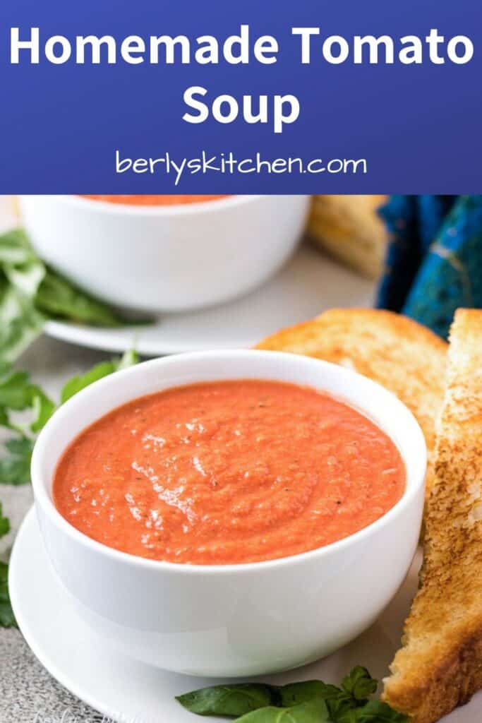 Tomato basil soup in a bowl served with a grilled cheese sandwich.