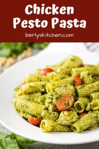 Chicken pesto pasta tossed with red onions and grape tomatoes.