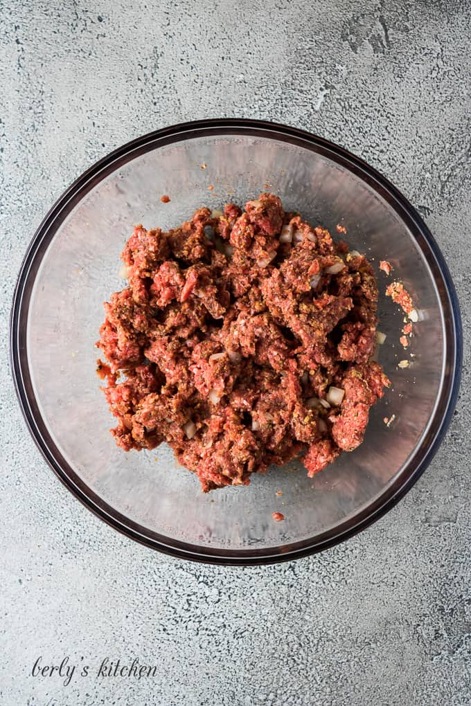 The ground beef and other ingredients have been properly combined.