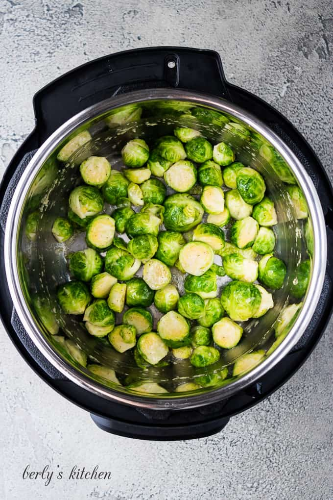 The cooked Brussel sprouts and melted butter have been stirred.