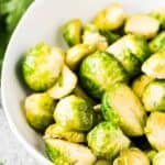 A close-up view of the buttered sprouts in a bowl.