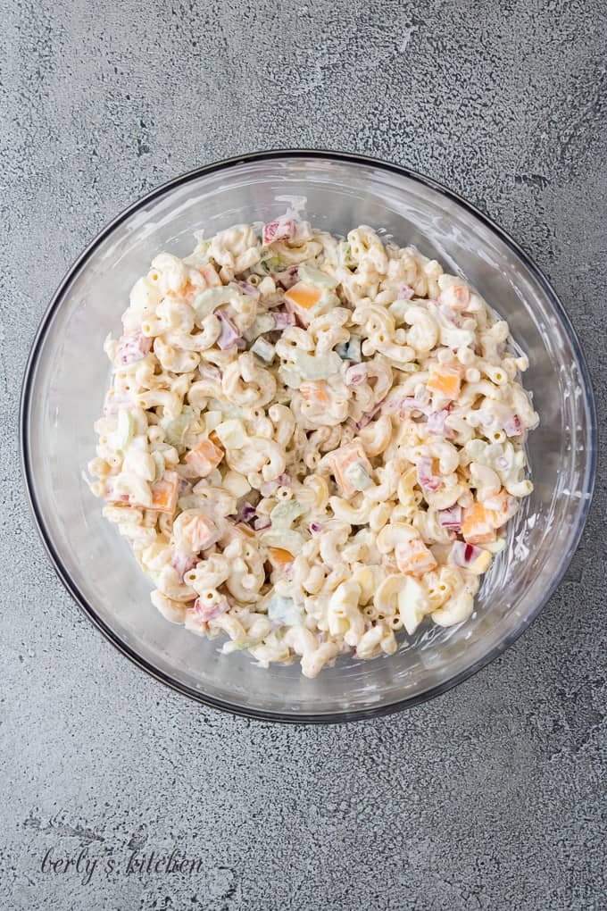 The macaroni pasta and mayo dressing mixed in the bowl.