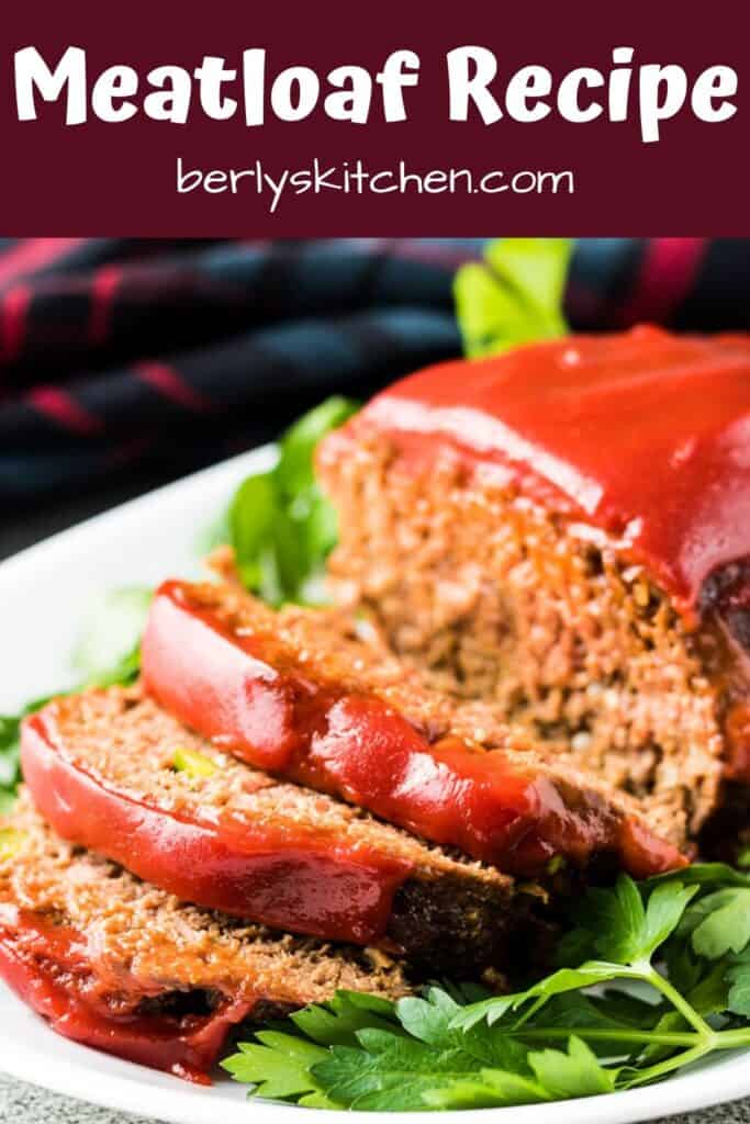 The finished meatloaf has been topped with ketchup and sliced.