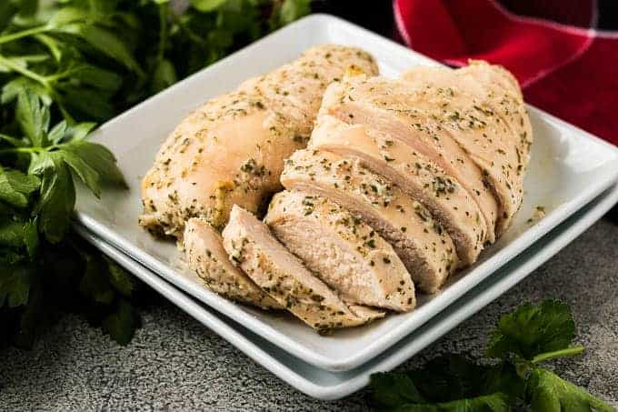 Two oven baked ranch chicken breasts sliced in a bowl.