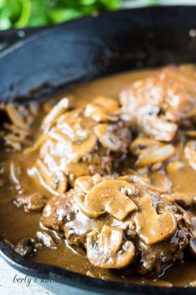 A close up of the finished salisbury steaks with gravy.