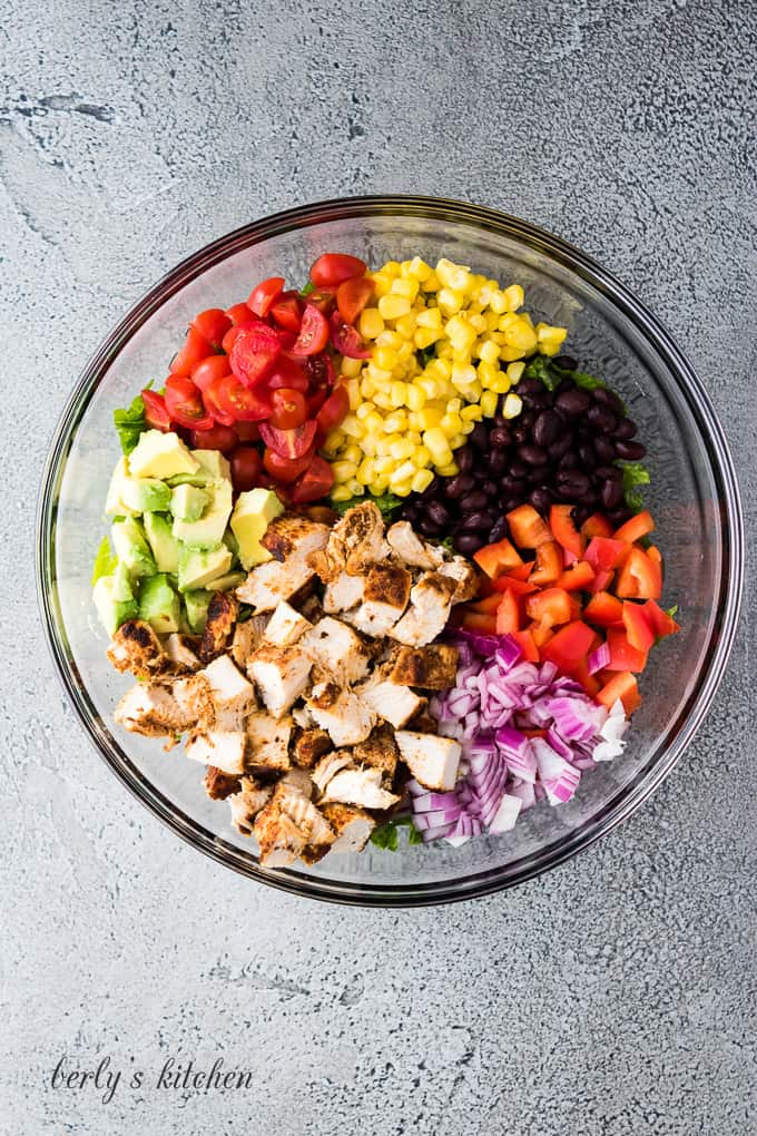 Chopped chicken, corn, and other ingredients in a mixing bowl.