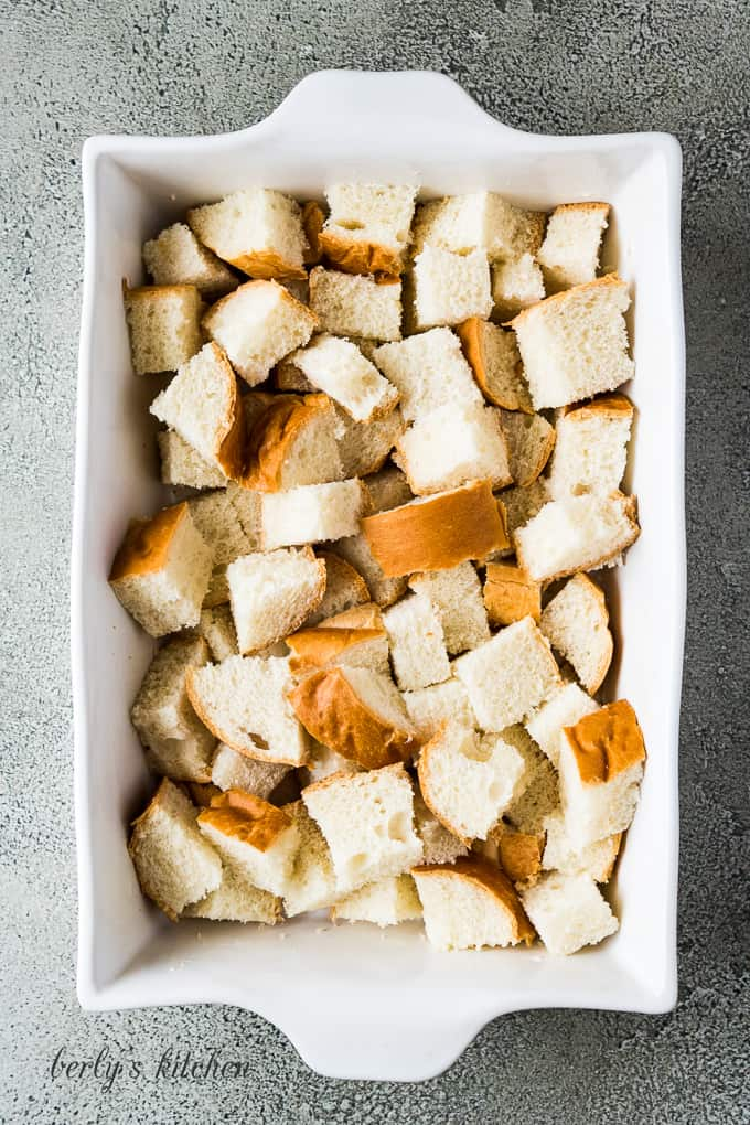 Chunks of bread have been added to the casserole dish.