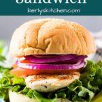 The grilled chicken sandwich on a bun with crunchy veggies.