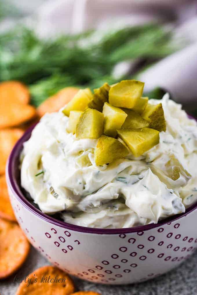 The finished dip has been garnished with more diced pickles.