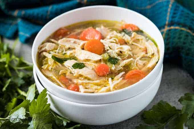 A bowl of the homemade chicken soup showing the ingredients.