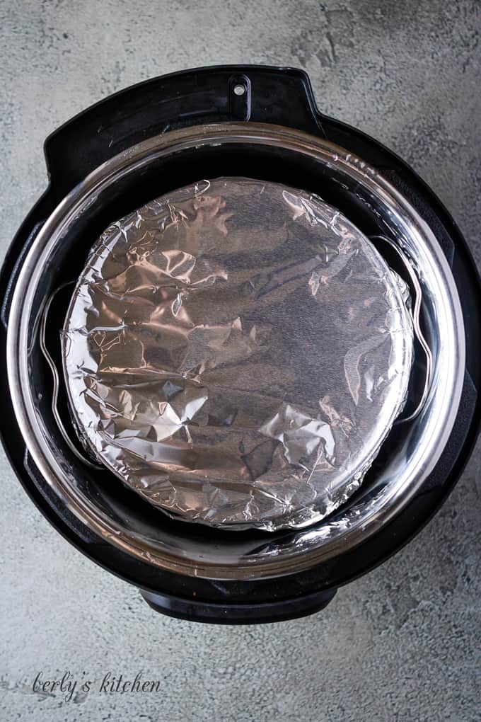 The baking dish covered in foil and moved to a pressure cooker.