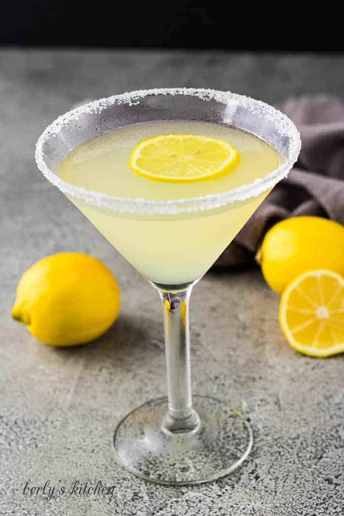 The finished martini garnished with a sugared rim and fresh lemon.