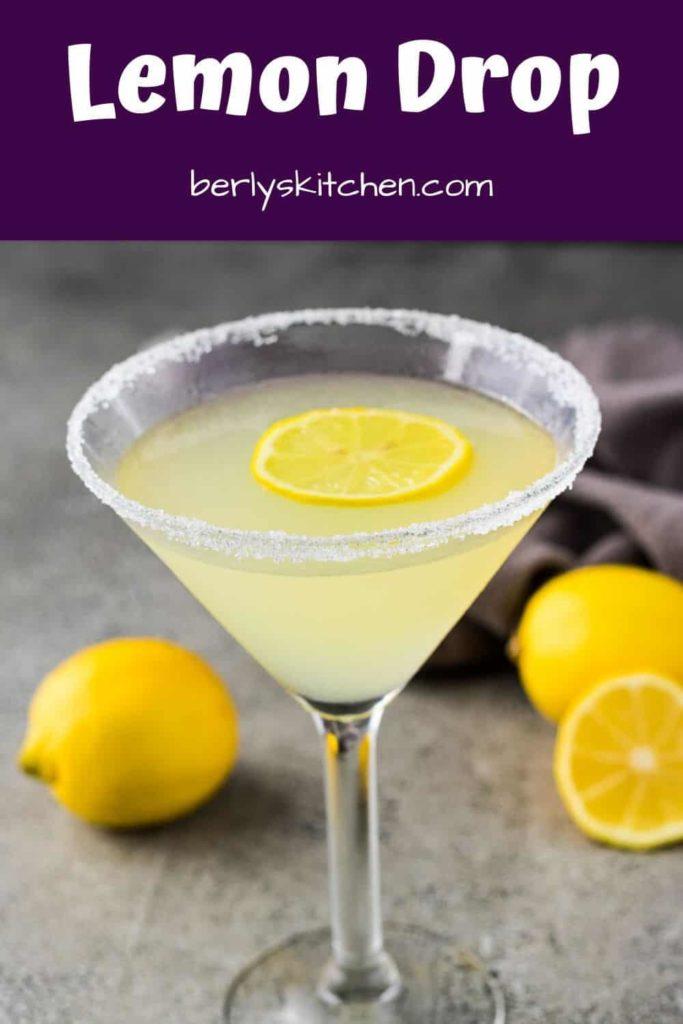 A finished lemon drop martini garnished with a lemon slice.