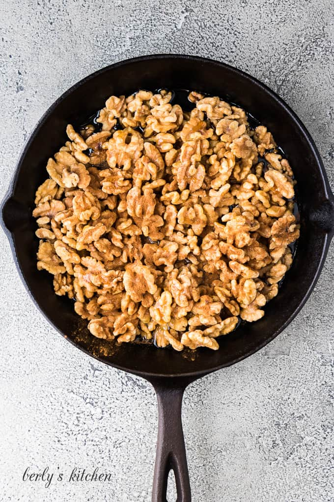 The walnuts and other ingredients in a cast iron skillet.