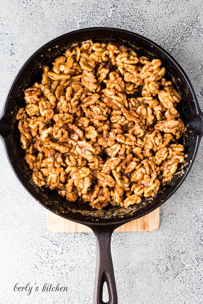 The nuts and maple syrup have cooked in the pan.