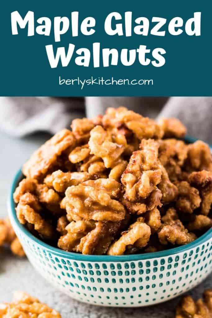 Maple glazed candied walnuts in a small decorative green bowl.