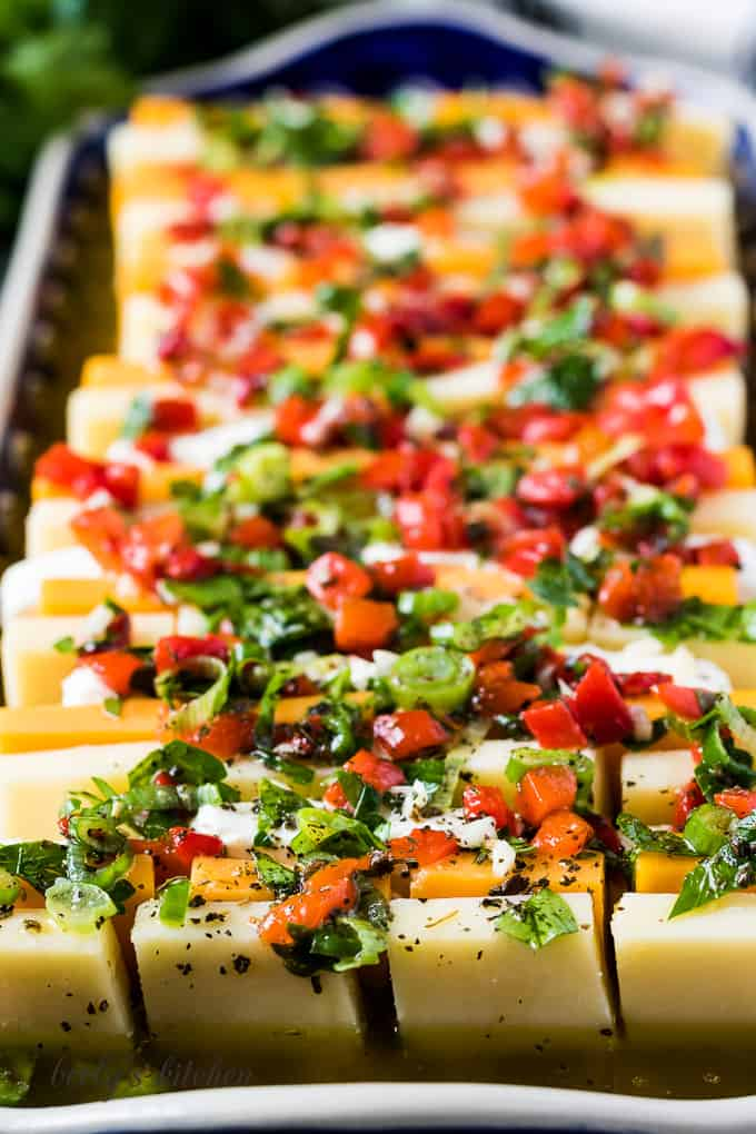The marinated cheese on a platter showing the colorful recipe.
