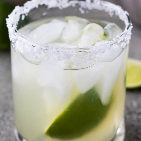 The margarita on the rocks with a fresh lime wedge.