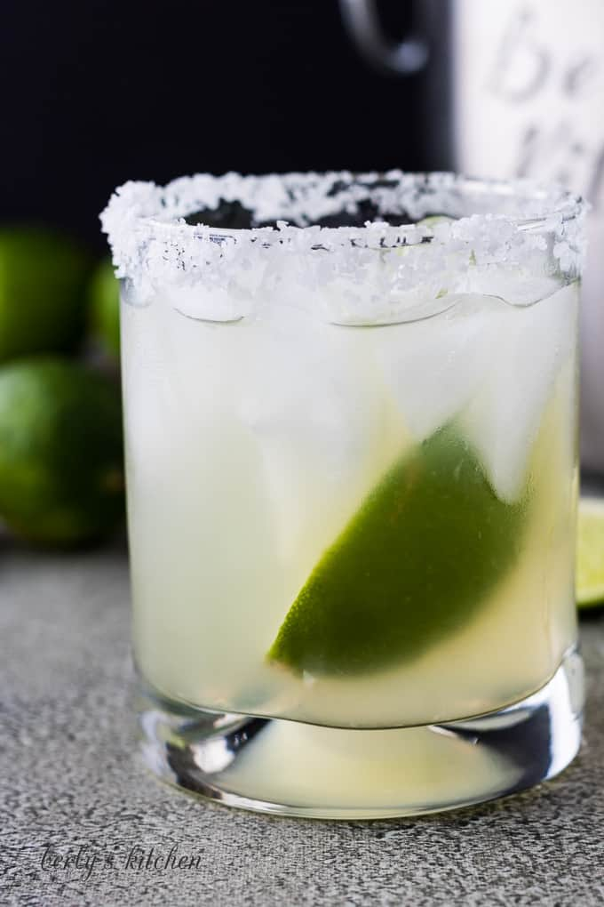 The tequila cocktail in a glass with a salted rim.