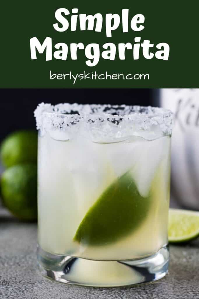 The finished simple margarita recipe served with ice and lime.
