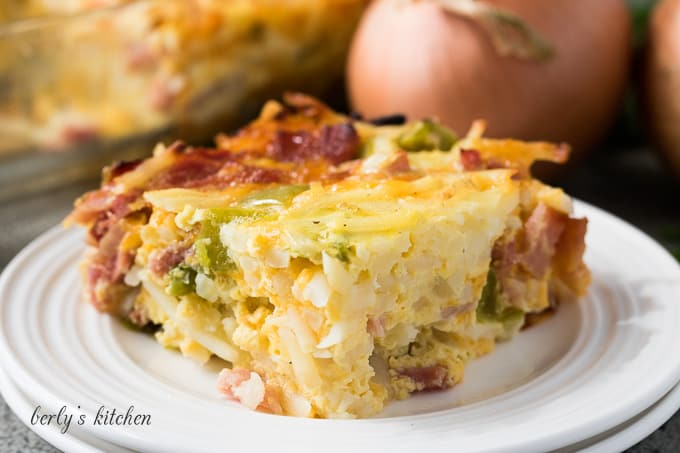A piece of breakfast casserole in a small plate.