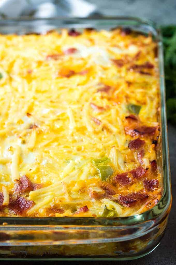 The baked cheesy breakfast casserole in a pan.