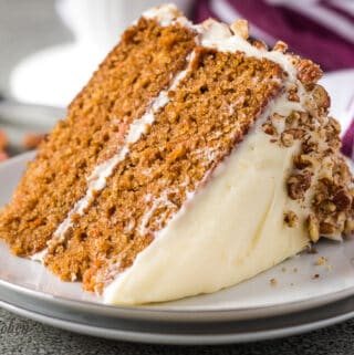 A slice of the moist carrot cake on a plate.