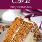 A big slice of carrot cake with cream cheese frosting.