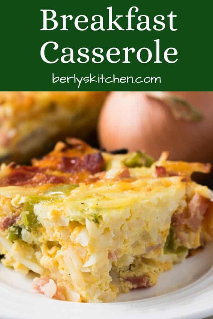 A slice of the cheesy breakfast casserole on a plate.
