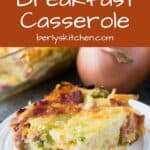 A piece of the finished cheesy breakfast casserole with hash browns.