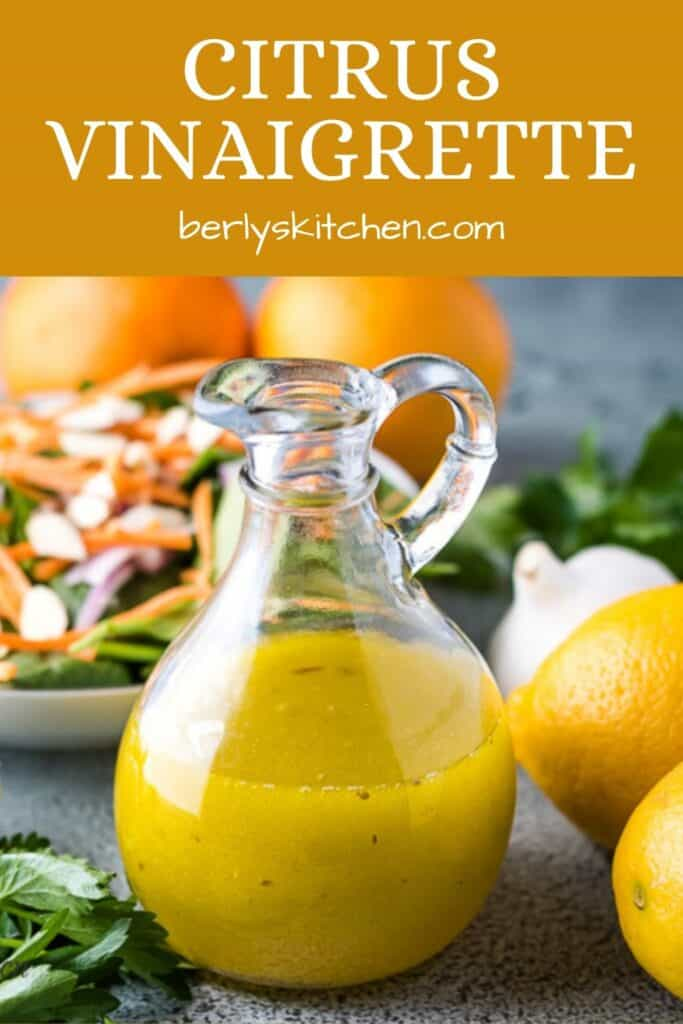 The orange citrus vinaigrette surrounded by fresh lemons and garlic.