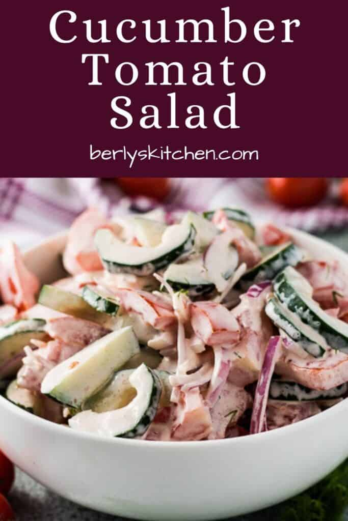Creamy cucumber tomato salad covered in dill sauce.