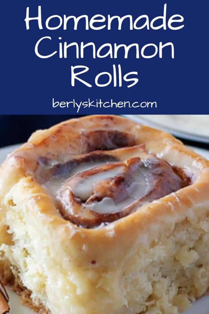 Close up photo of a cinnamon roll with blue and white text overlay used for Pinterest.