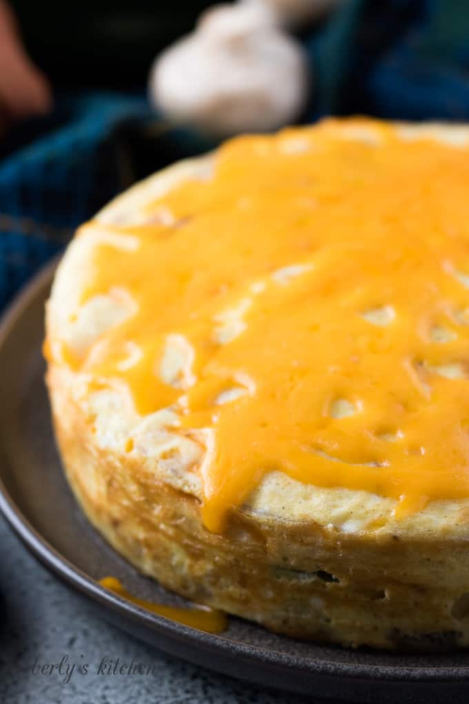 The Instant Pot frittata topped with melted cheddar cheese.